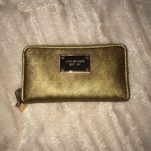 MK zip around metallic gold leather wallet